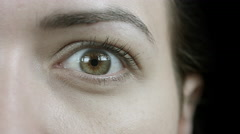 Close-Up Worried And Shocked Female Eye Stock Footage