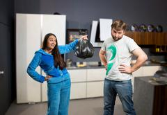 Wife asking her husband to take out the trash Stock Photos
