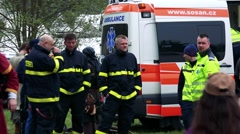 Rescuers and firemen stand at car and talk Stock Footage