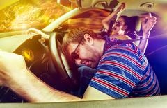 Couple driving in the car - stock photo