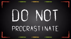 Chalk text Do not procrastinate on blackboard Stock Footage
