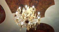 Beautiful crystal chandelier hangs on ceiling Arkistovideo