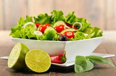 Composition with vegetable salad bowl. Balanced diet. Stock Photos