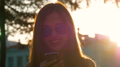 Attractive girl using mobile phone in a city Stock Footage