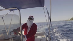Funny Santa Claus driving fast speed motor boat, in sea Stock Footage