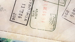 Stamps in passport Stock Footage