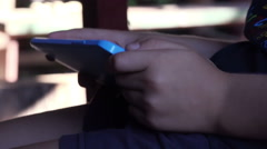 Hands of a small boy playing video game on tablet Stock Footage