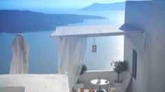 White apartment room with a sea view in Greece, Santorini, Sunny day Stock Footage