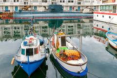 Genoa. Fishing boats in the seaport. Stock Photos