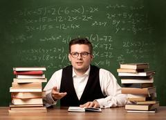 Math teacher at desk Stock Photos