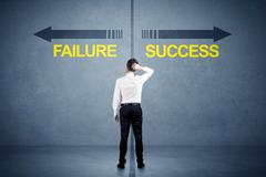 Businessman standing in front of success and failure arrow concept Stock Photos