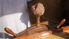 Man controls the steering wheel of the old ship Stock Footage