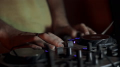 Dj playing and mixing music in a night club - stock footage