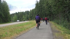 Cruise ship bicycle tour the Mendenhall NP Stock Footage