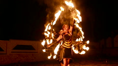 Graceful girls and boys dancing passionate dance with fire fan in his hand. Fire Stock Footage