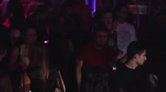 Man and woman dance on party in crowded nightclub. Spotlights. Holidays. Fun Stock Footage