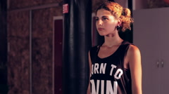 Young cute girl dancing in dark studio Stock Footage