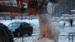 Backhoe loader pour off dirty snow, by opening steel clamshell bucket Stock Footage