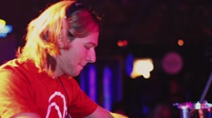 Dj spinning at turntable on party in nightclub. Dancing under beats. Laptop Stock Footage