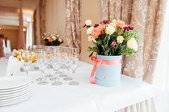 Wedding glasses filled with champagne at banquet - stock photo