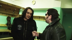 Soloist rock band Kukryniksy Alex Gorshenev give interview to adult man in Stock Footage