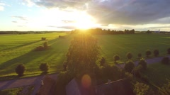 Flight over beautiful field and trees on background. Aerial rural landscape. Stock Footage