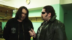 Soloist rock band Kukryniksy Alex Gorshenev give interview backstage of Stock Footage
