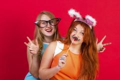 Young nice girls have fun on a christmas party - stock photo