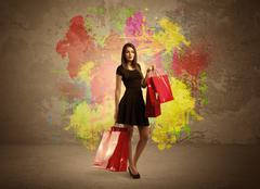 Girl with shopping bags and paint splatter Stock Photos