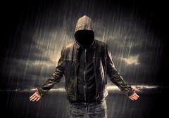 Anonymous terrorist in hoodie at night Stock Photos