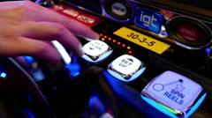 Close up woman pressing bet down button on slot machine - stock footage