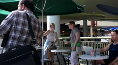 One side of people drinking coffee and chatting inside Starbucks store Stock Footage