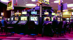 Motion of people playing slot machine with grand prize car on spinning stage Stock Footage
