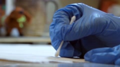 The Process of Restoration of Old Paintings in the Laboratory. Close Up. Stock Footage