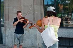 Duo of improvisation violinists Stock Photos