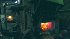 Steelmakers throw scrap to be melted in a melting furnace. Overall plan Stock Footage