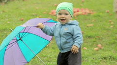 Kid, baby with umbrella in park. Summer scene in nature. Fun holidays. Childhood Stock Footage