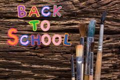 Back to School desk table top view, words on grunge old wooden board background Stock Photos