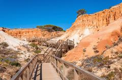 Wooden path to Falesia Beach in Portugal Stock Photos