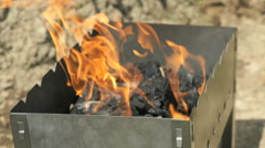 Flames with sparks on the coals in the grill Stock Footage