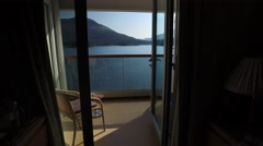 Walking Through The Open Sliding Door Of A Cruise Ship Cabin In Alaska Stock Footage