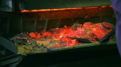Steelmaker removes the metal waste from the melting furnace Stock Footage