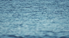 Calm tranquil sea surface telephoto 100p slowmotion Stock Footage