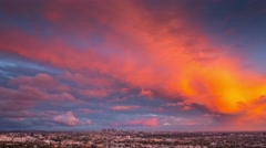 Red orange storm clouds city Los Angeles skyline cityscape at sunset timelapse Stock Footage