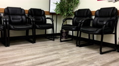 Motion of empty chair for patient waiting place inside BC medicial office Stock Footage