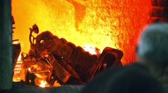 Steelmakers are loaded scrap metal to the melting furnace for remelting Stock Footage