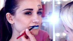 Young girl, fashion, studio makeup, lip pencil, slow motion, 4K, UHD, UltraHD Stock Footage