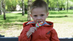 Kid with colorful candy outdoor Stock Footage
