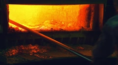 Steelmakers removes the metal waste from the melting furnace Stock Footage