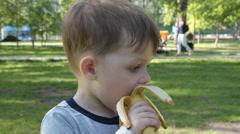 Little kid eating banana Stock Footage